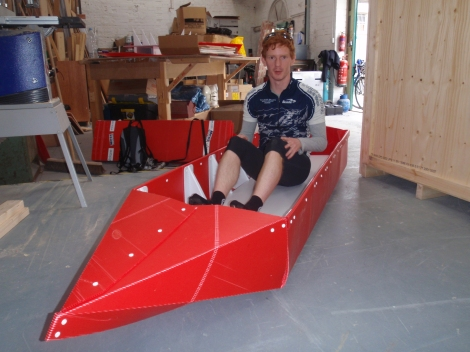 Tom in origami canoe